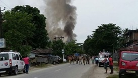 Gunmen kill 12 in attack on market in northeast India