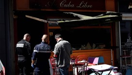 Police officers and firefighters inspect the damaged Au Cuba Libre bar in Rouen