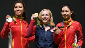 USA's gold medallist Virginia Thrasher (C) poses on the podium with China's silver medal winner Du L