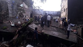People search the collapsed building for survivors