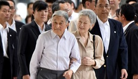 Japanese Emperor Akihito (centre L) and Empress Michiko (centre R) upon