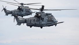French Caracal helicopters flying during an air-to-air refuelling exercise