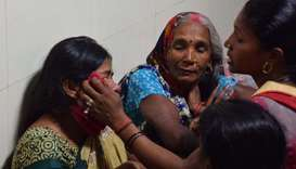 Relative mourn the death of a children at Baba Raghav Das Hospital in Gorakhpur district of the Indi
