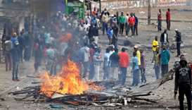 Protesters set barricade on fire in Mathare, in Nairobi