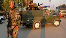 Indian army personnel arrive at the site of attack