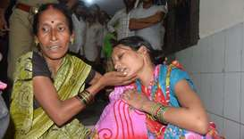 Relatives mourn the death of a children at Baba Raghav Das Hospital in Gorakhpur district of the Ind