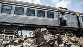 Egypt jails four people over deadly train collision