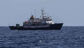 A banner that reads 'Stop Human Trafficking' attached to the side of the C-Star vessel as it sails i