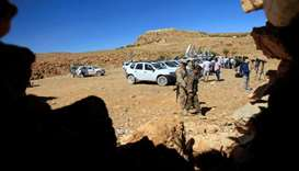 Hezbollah fighters and journalists vans are seen in Jroud Arsal, near Syria-Lebanon border, August 1