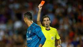Real Madrid's Cristiano Ronaldo is shown a red card by referee Ricardo de Burgos Bengoetxea