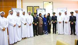 Qatar Airways personnel with participants of the open recruitment day