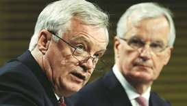 Davis and European Union's chief Brexit negotiator Barnier (right) at a joint news conference after