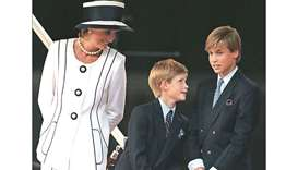 An August 19, 1995 picture of Diana, Princess of Wales and her sons Princes Harry and William attend