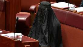 Australian politician Pauline Hanson wears burqa in Senate
