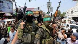 Palestinian Hamas militants attend the funeral of their comrade in Rafah in the southern of Gaza Str
