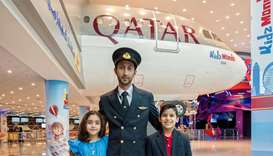 Qatar Airways' Qatari Captain Al Yafei Abdulaziz with eight year-old Maryam Mahasneh and eight year-