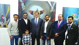 Ambassador Yousef bin Ali al-Khater with guests and dignitaries at Transition art exhibition opening