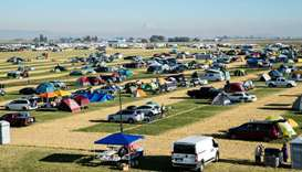 "Campers form ""Solar Town,"" an agricultural field turned campground for total solar eclipse enthusias"