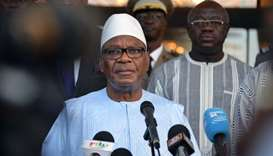 Mali's President Ibrahim Boubacar Keita speaks to the press upon his arrival at Ouagadougou airport