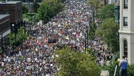 A large crowd of people march towards the Boston Commons to protest the Boston Free Speech Rally in