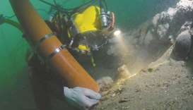 An undated handout picture released by Historic England in London on Friday shows a diver working on