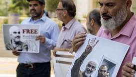 Arab-Israeli supporters of Sheikh Raed Salah (portrait), leader of the radical northern branch of th