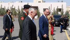 US Defense Secretary James Mattis (C-L) walks with Jordan's Prince Faisal (C-R), the brother of King