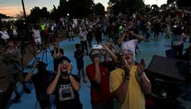 People watch the solar eclipse in downtown Hopkinsville, Kentucky