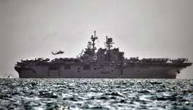 U.S Navy's USS America, which is supporting ongoing search for missing crew members of USS John McCa