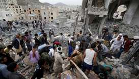 People search under rubble of a house destroyed by a Saudi-led air strike in Sanaa, Yemen