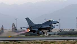 A US Air Force F-16 Fighting Falcon aircraft takes off for a night-time mission at Bagram Airfield,