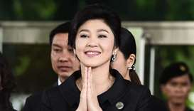 Former Thai prime minister Yingluck Shinawatra greeting her supporters as she leaves the Supreme Cou