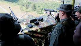Venezuelan army and militias hold exercises after US threat