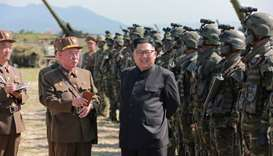 North Korean leader Kim Jong Un guides a target-striking contest of the special operation forces of
