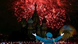 Fireworks explode above the St. Basil Cathedral as participants perform during the Festival