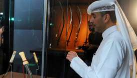 Fadel al-Mansoori briefs reporters at the opening of the exhibition