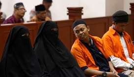 Dian Yulia Novi (2nd L), arrested last year on suspicion of plotting to blow herself up outside the