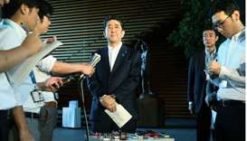 Japan's Prime Minister Shinzo Abe speaks to the media at his official residence in Tokyo on August 2
