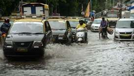 Death toll from Mumbai floods jumps to 14, rain eases