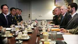 U.S. Secretary of Defense Jim Mattis (2nd R) and South Korean Defense Minister Song Young-Moo (L) du
