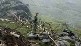 Chinese soldier stands guard on the Chinese side of the border crossing between India and China