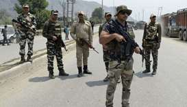 Indian paramilitary troopers stand guard near the scene of a gunbattle