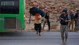 Syrian militants, refugees arrive in rebel zone from Lebanon