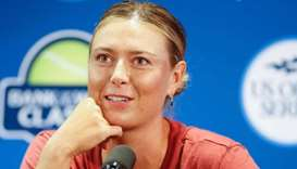Sharapova withdraws from Stanford with left arm injury
