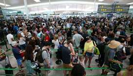 Travellers face delays as Barcelona airport security staff strike