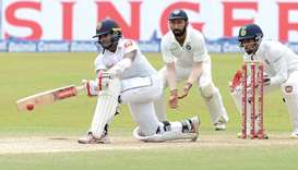 Mendis hits defiant ton but India on top
