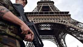 France opens terror probe after man tries to enter Eiffel Tower