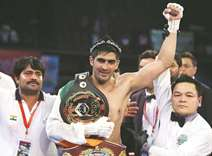 Indian boxer offers to trade title for peace with China