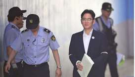 Lee Jae-Yong (R), the vice-chairman of Samsung Electronics, is escorted by prison guards