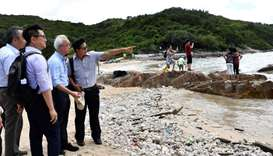 Under Secretary for the Environment Tse Chin-wan, visits a beach at Lamma Island on the progress of